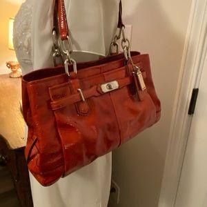 Red patent coach purse